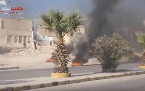 Жители Алеппо укрываются от авиаударов с помощью горящих покрышек (Видео)